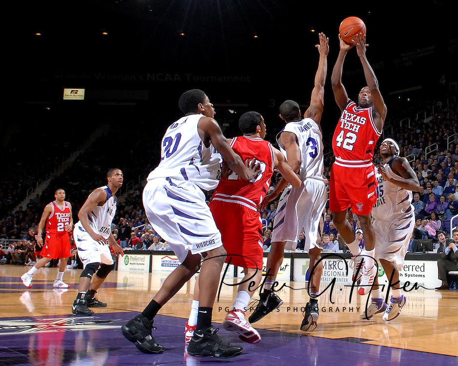 Texas Tech guard Charlie Burgess (42) drives to the basket over Kansas State's Lance Harris (3) during the first half at Bramlage Coliseum in Manhattan, Kansas, January 8, 2007.  Texas Tech beat K-State 62-52.