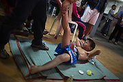 Jan 24, 2014 - Chiang Mai, Thailand - <br /> <br /> Nine Year Old Muay Thai Fighter<br /> <br />  Focus winces in pain from the massage he receives before his fight at the Thapae Muay Thai Stadium in Chiang Mai. PETCHFOGUS SITTHAHARNAEK, 9, aka Focus is the top fighter for his age and weight in Chiang Mai. He has begun fighting older, heavier opponents to continue to improve his skills. Fighters are typically paid 1000 baht (0) per fight. <br /> ©Exclusivepix