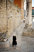 Zadar, Croatia, Jun 16, 2010, Catholic nun crossing the Forum. PHOTO © Christophe Vander Eecken  .