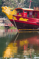 Hue is well-known for its dragon boats and boat excursions along the Perfume River. Visitors cruise on these boats to visit the Vietnamese royal mausoleums and a few pagodas and temples along the way.  Spectacular dragons are carved into the boat's bow.