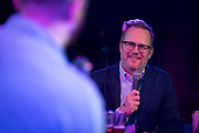 "Jason Joyce laughs during the live taping of the ""Madsplainers"" Podcast at High Noon Saloon in Madison, WI on Tuesday, April 9, 2019."