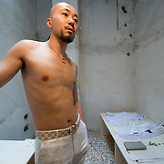 """VENICE, ITALY - JUNE 04:  Chinese artist  Xing Xin exhibits himself in the installation """"2011 I exhibit myself in a Western Exhibition"""" on June 4, 2011 in Venice, Italy. The Venice Art Biennale will run from June 4 to November 27, 2011."""