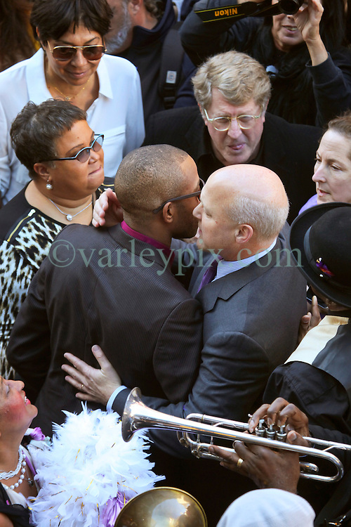 20 November 2015. Orpheum Theater, New Orleans, Louisiana. <br /> Memorial service for musician Allen Toussaint. Mayor Mitch Landrieu, Troy 'Tombone' Shorty and Quint Davis gather in the streets as people  spill out of the Orpheum Theater in a second line procession following the touching memorial service for one of the city's most influential musicians. <br /> Photo; Charlie Varley/varleypix.com