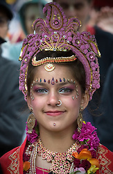 © licensed to London News Pictures. 12/06/2011. London, UK. A  girl with her face painted during the Hare Krishna Ratha-yatra Festival of Chariots in London today (12/06/2011). 3 giant chariots are pulled from Hyde Park to Trafalger square accompanied by a procession of singers, musicians, and dancers. Rathayatra is celebrated by devotees of Lord Krishna all over the world. Photo credit should read: Ben Cawthra/LNP