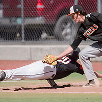 Gallup Bengal Jacob Burke (20) dives back to first base to avoid a pickoff from Aztec Tiger Kyler Duggins (15) Saturday at Ford Canyon Park in Gallup.