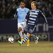 Seth Sinovic, (right), SPorting KC, is challenged by Tony Taylor, NYCFC, during the New York City FC Vs Sporting Kansas City, MSL regular season football match at Yankee Stadium, The Bronx, New York,  USA. 27th March 2015. Photo Tim Clayton