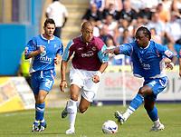 Photo: Daniel Hambury.<br />Gillingham v West Ham United. Pre Season Friendly. 29/07/2006.<br />West Ham's Bobby Zamora gets past and Gillingham's Brent Sancho.