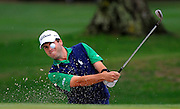 Ben Martin hits out of the bunker on the ninth green during the second round of the RBC Heritage golf tournament in Hilton Head Island, S.C., Saturday, April 19, 2014. Play was suspended during the second round Friday due to weather and resumed today.  (AP Photo/Stephen B. Morton)
