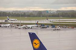 THEMENBILD - Airport Muenchen, Franz Josef Strauß (IATA: MUC, ICAO: EDDM), Der Flughafen Muenchen zählt zu den groessten Drehkreuzen Europas, rund 100 Fluggesellschaften verbinden ihn mit 230 Zielen in 70 Laendern, im Bild Seitenruder einer Lufthansa Maschine mit Logo, dahinter  Flugzeuge in der Warteschleife // THEME IMAGE, FEATURE - Airport Munich, Franz Josef Strauss (IATA: MUC, ICAO: EDDM), The airport Munich is one of the largest hubs in Europe, approximately 100 airlines connect it to 230 destinations in 70 countries. picture shows: Rudder of a Lufthansa plane with logo, behind aircraft in the queue, Munich, Germany on 2012/05/06. EXPA Pictures © 2012, PhotoCredit: EXPA/ Juergen Feichter