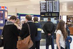 © Licensed to London News Pictures . 22/12/2012 . London , UK . GV General View of people and departure boards at Heathrow Airport Terminal 1 departure lounge . Photo credit : Joel Goodman/LNP