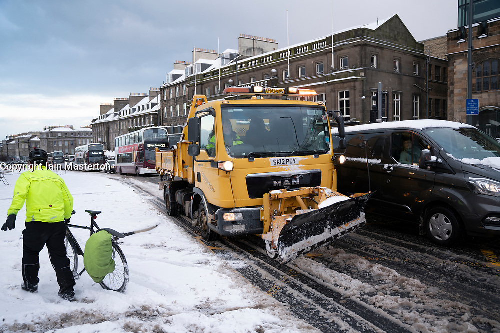 Edinburgh, Scotland, UK. 10 Feb 2021. Big freeze continues in the UK with heavy overnight and morning snow bringing traffic to a standstill on many roads in the city centre. Pic; Snowplough stuck in traffic on Leith Walk as road is blocked further on.  Iain Masterton/Alamy Live news