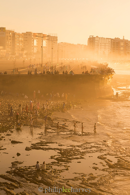 People at sunset on beach in Casablanca, Morocco