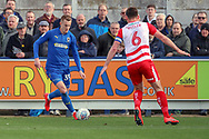 AFC Wimbledon striker Joe Pigott (39) taking on Doncaster Rovers defender Andy (Andrew) Butler (6) during the EFL Sky Bet League 1 match between AFC Wimbledon and Doncaster Rovers at the Cherry Red Records Stadium, Kingston, England on 9 March 2019.