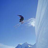 John Bengen jumps big cornice at Mt. Baker ski area, WA. MT. Shuksan bkg.