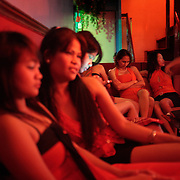 Girls frequenting a karaoke bar on October 10, 2008 in Adriatico Street, Malate, Manila, the Philippines. Photo Tim Clayton