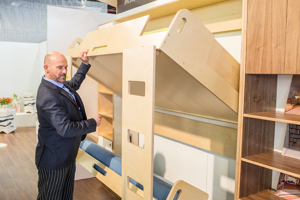 Designer Roberto Gil of Casa Kids unfolds a bunk bed with integral ladders at BklynDesigns at the Brooklyn Expo Center in Greenpoint. BklynDesigns is part of NYCxDesign, a week-long design festival in New York City.