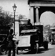 General strike in Britain, 1926. Policeman on traffic duty at Hyde Park Corner, London, waving on an army armoured car.