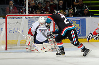 KELOWNA, CANADA, OCTOBER 5: Ty Rimmer #35 of the Tri City Americans saves a shot on net by Tyson Baillie #24 of the Kelowna Rockets  on October 5, 2011 at Prospera Place in Kelowna, British Columbia, Canada (Photo by Marissa Baecker/shootthebreeze.ca) *** Local Caption ***Ty Rimmer;Tyson Baillie;