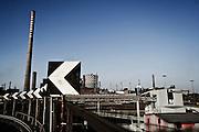 Veduta panoramica di una parte dell'impianto siderurgico Ilva di Taranto. In questa zona, a ridosso del quartiere Tamburi, sono depositati i minerali utilizzati poi per produrre l'acciaio.<br /> Foto Christian Mantuano / OneShot