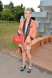 BELLA HOWARD at a party hosted by fashion store COS to celebrate The Serpentine Park Nights 2016 held at The Serpentine Gallery, Kensington Gardens, London on 12th July 2016.