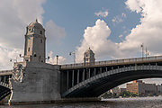 """The Longfellow Bridge is a steel rib arch bridge spanning the Charles River to connect Boston's Beacon Hill neighborhood with the Kendall Square area of Cambridge, Massachusetts. The bridge carries Massachusetts Route 3, US Route 3, the MBTA Red Line, bicycle, and pedestrian traffic. The structure was originally known as the Cambridge Bridge, and a predecessor structure was known as the West Boston Bridge; Boston also continued to use """"West Boston Bridge"""" officially for the new bridge. The bridge is also known to locals as the """"Salt-and-Pepper Bridge"""" due to the shape of its central towers."""