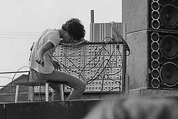 Ned Lagin at his synthesizer board before the Grateful Dead Concert at Dillon Stadium on 31 July 1974. B&W Original Film Scan from a photograph shot with a Nikon FTn Camera and Tri-X film.