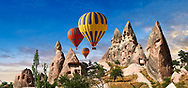 Pictures & images of hot air balloons over Uchisar Castle & the cave city houses in the rock formations & fairy chimney of Uchisar, near Goreme, Cappadocia, Nevsehir, Turkey .<br /> <br /> If you prefer to buy from our ALAMY PHOTO LIBRARY  Collection visit : https://www.alamy.com/portfolio/paul-williams-funkystock/cappadocia-balloons.html<br /> <br /> Visit our TURKEY PHOTO COLLECTIONS for more photos to download or buy as wall art prints https://funkystock.photoshelter.com/gallery-collection/3f-Pictures-of-Turkey-Turkey-Photos-Images-Fotos/C0000U.hJWkZxAbg
