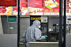 © Licensed to London News Pictures. 21/08/2018. London, UK. Forensics at the scene of a double shooting Chicken Cottage on Rayners Lane, Harrow, north London. Armed police are reported to be searching the area after two men were shot in broad daylight. Their condition is unknown. This follows two separate shooting incidents in London yesterday. Photo credit: Ben Cawthra/LNP