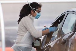 © Licensed to London News Pictures. 31/03/2020. London, UK. A NHS staff member tests other members of the NHS for Covid-19 at a drive-through facility at IKEA Wembley in London. The facility is only available to NHS staff members. Photo credit: Ray Tang/LNP