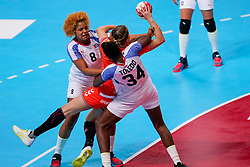 03-12-2019 JAP: Netherlands - Cuba, Kumamoto<br /> Third match 24th IHF Women's Handball World Championship, Netherlands win the third match against Cuba with 51- 23. / Merel Freriks #19 of Netherlands, Arisleidy Marquez Herrera #8 of Cuba, Yennifer Amanda Toledo Abreu #34 of Cuba