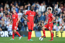 Liverpool's Mario Balotelli and Liverpool's Joe Allen cuts a dejected figure - Photo mandatory by-line: Dougie Allward/JMP - Mobile: 07966 386802 - 19/10/2014 - SPORT - football - London - Loftus Road - QPR v Liverpool - Barclays Premier League