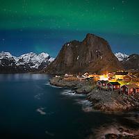 Northern Lights - Aurora Borealis shine in sky over Hamnøy, near Reine, Moskenesøy, Lofoten Islands, Norway