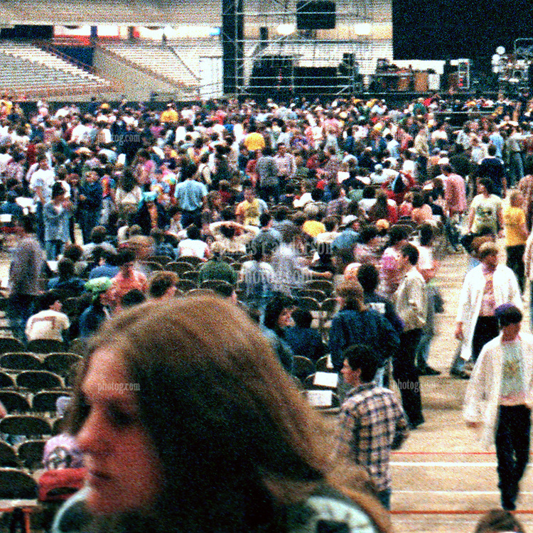 Detail of crowd left of center. A slice of the full Interior of the Venue before the start of the Grateful Dead in Concert at the Carrier Dome, Syracuse University, New York on the 20th of October 1984. Photographed Dead Center Rear view Forward.