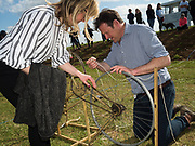 CATHERINE CAZALET;; PADDY HOARE, SETTING UP THE LURE PULLING MACHINE FOR THE DOG RACES, Heythrop Point to Point, Cocklebarrow, 2 April 2017.