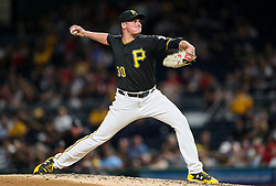 Jun 15, 2018; Pittsburgh, PA, USA; Pittsburgh Pirates relief pitcher Kyle Crick (30) throws a pitch during the eighth inning against the Cincinnati Reds at PNC Park. Mandatory Credit: Ben Queen-USA TODAY Sports