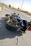 Israel, A motorbike lies on the road after a traffic collision