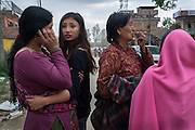 Devastating April 2015 Nepal Earthquake. Bungamati, Kathmandu Valley, shortly after the earthquake struck. People in distress, trying to get in contact with their families.