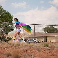 Miaya Watchman, 17, of Window Rock walks along with the Diné Pride parade Saturday, June 19 in Window Rock.