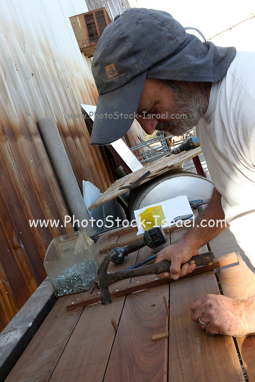 Traditional Carpenter at work in his workshop