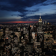 A vertical view of Manhattan, New York, at dusk from the Top of the Rock, the observatory deck at Rockefeller Center showing the Empire State Building, Manhattan, New York, USA.  Photo Tim Clayton