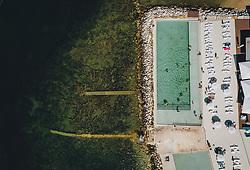 THEMENBILD - Touristen geniessen die Strände und einen Pool des Ortes an der oberen Adria, aufgenommen am 03. Juli 2020 in Novigrad, Kroatien // Tourists enjoy the beaches and a Pool of the village on the upper Adriatic Sea in Novigrad, Croatia on 2020/07/03. EXPA Pictures © 2020, PhotoCredit: EXPA/ JFK