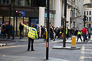 Members of the public run away from the area as the City of London is locked down by Metropolitan and City Police following what is believed to have been a terror-related incident on London Bridge at around 2pm on 29th November 2019 in London, United Kingdom. Police officers cordoned off the bridge, underpass and all surrounding roads following the incident during which members of the public intervened before shots were fired by armed police. The incident is said to have started as a stabbing during which a number of people were stabbed in a building near London Bridge.