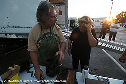 """Ron Julian (""""RJ""""), working on his honing machine to help Claudia Ganzaroli of Italy after the hosted dinner stop at Grand Junction Harley-Davidson during Stage 10 (278 miles) of the Motorcycle Cannonball Cross-Country Endurance Run, which on this day ran from Golden to Grand Junction, CO., USA. Tuesday, September 15, 2014.  Photography ©2014 Michael Lichter."""