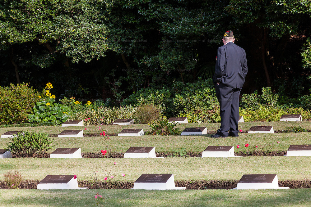 A United States veteran looks at war graves after a Remembrance Day ceremony at the Yokohama War Cemetery, Hodogaya. Yokohama, Japan. Sunday November 9th 2014
