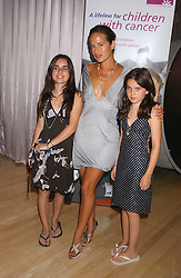 JADE JAGGER with her daughters ASSISI and AMBA at party in aid of cancer charity Clic Sargent held at the Sanderson Hotel, Berners Street, London on 4th July 2005.<br /><br />NON EXCLUSIVE - WORLD RIGHTS