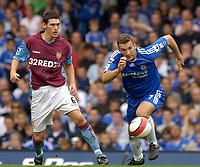 Photo: Daniel Hambury.<br />Chelsea v Aston Villa. The Barclays Premiership. 30/09/2006.<br />Chelsea's Andriy Shevchenko and Villa's Gareth Barry.