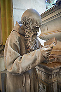 Pictures and image of a realistic style  stone sculpture of a priest, monumental tombs of the Staglieno Monumental Cemetery, Genoa, Italy .<br /> <br /> Visit our ITALY PHOTO COLLECTION for more   photos of Italy to download or buy as prints https://funkystock.photoshelter.com/gallery-collection/2b-Pictures-Images-of-Italy-Photos-of-Italian-Historic-Landmark-Sites/C0000qxA2zGFjd_k<br /> If you prefer to buy from our ALAMY PHOTO LIBRARY  Collection visit : https://www.alamy.com/portfolio/paul-williams-funkystock/camposanto-di-staglieno-cemetery-genoa.html