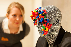 © Licensed to London News Pictures. 17/11/2016. London, UK. A staff member views a Lego-inspired mannequin display as The Design Museum opens in its new home on Kensington High Street, west London.  Housed in the former Commonwealth Institute, the building has been redesigned by John Pawson following an investment of £83m, and a five-year construction process for its future role as the world's leading institution dedicated to contemporary design and architecture. Photo credit : Stephen Chung/LNP