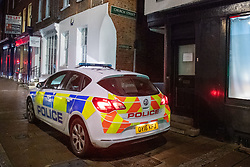 © Licensed to London News Pictures. 19/01/2021. Reading, UK. A police vehicle blocks a pedestrian path leading to Church Street in Reading. At approximately 20:15GMT on Monday 18/01/2021 in Church Street, Reading, a man in his forties was assaulted by a group of unknown offenders with weapons who fled the scene after the assault. The victim was taken to hospital with injuries consistent with having been stabbed. Photo credit: Peter Manning/LNP
