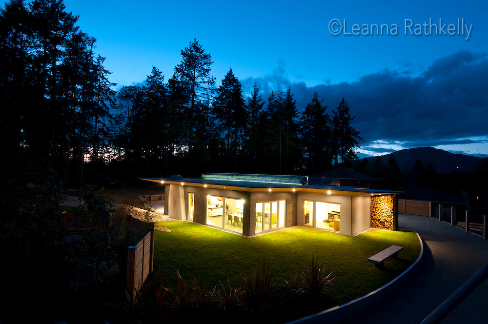 A contemporary-styled home in North Saanich on Vancouver Island was built using tilt-up concrete panels, large south-facing windows and a solar panel array on the flat roof.